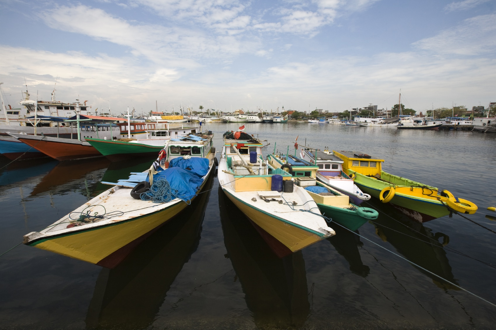 Makassar schooners (pinisi) in Paotere harbor, the old port of Makassar,  Indonesia