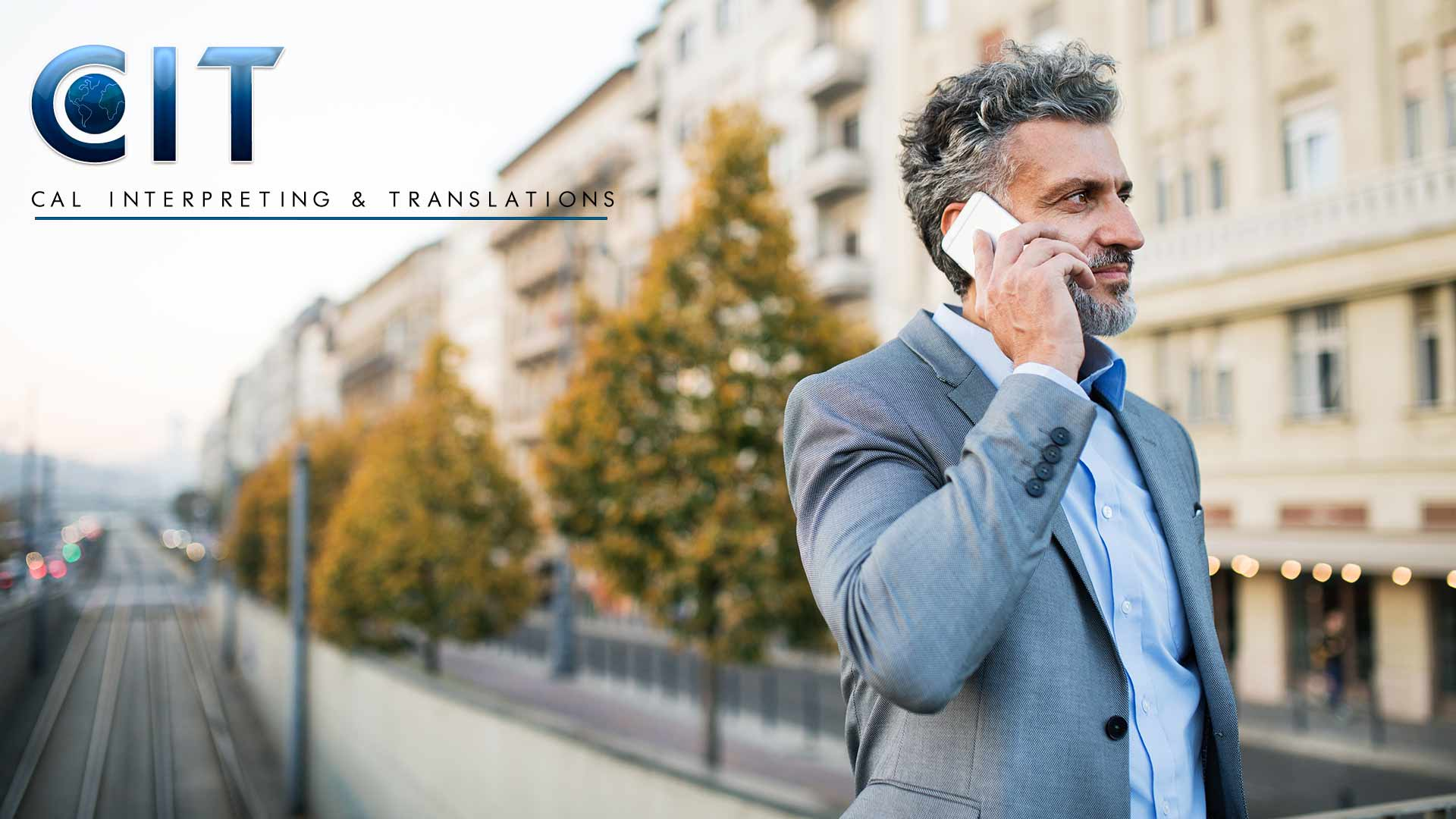 Business traveler using CIT telephonic interpreting service